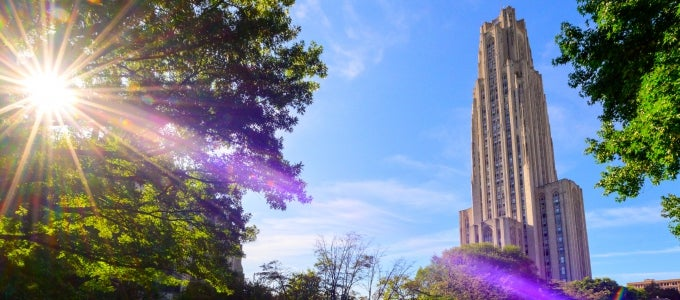 Cathedral of Learning with bright sun rays shining down